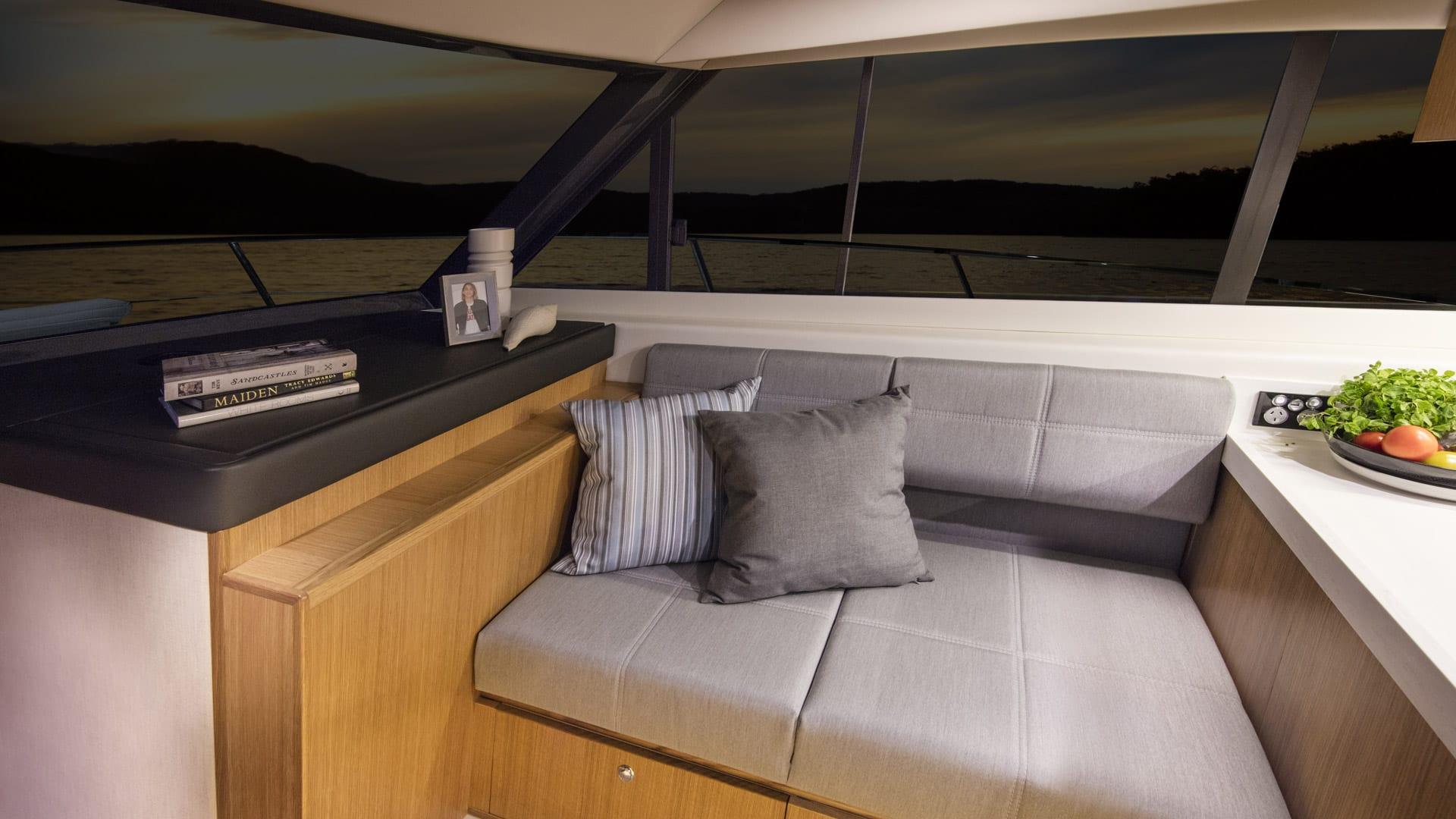 Riviera 39 Open Flybridge Forward Lounge – Satin Oak Timber Finish