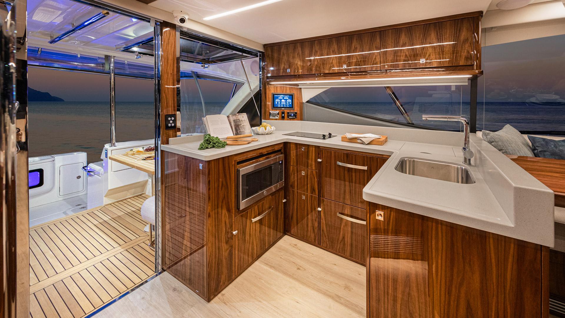 Riviera 50 Sports Motor Yacht Galley 01 – Gloss Walnut Timber Finish