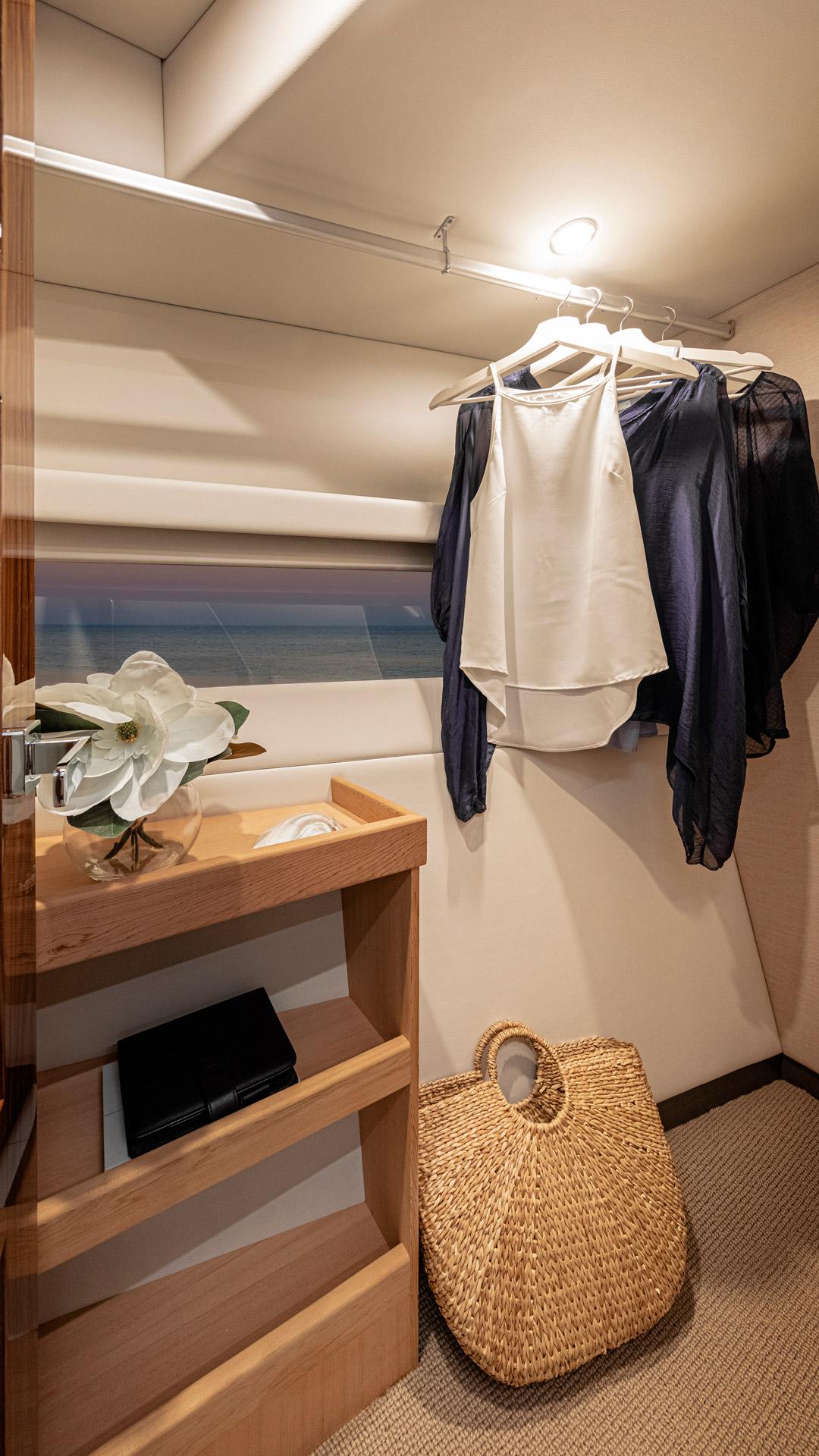 Riviera 50 Sports Motor Yacht Master Stateroom WIR 01 – Gloss Walnut Timber Finish
