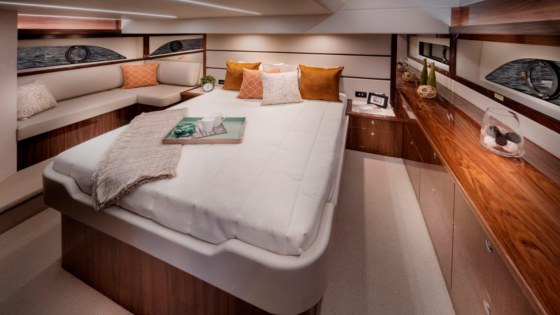 Riviera 54 Enclosed Flybridge Master Stateroom – Gloss Walnut Timber Finish 01