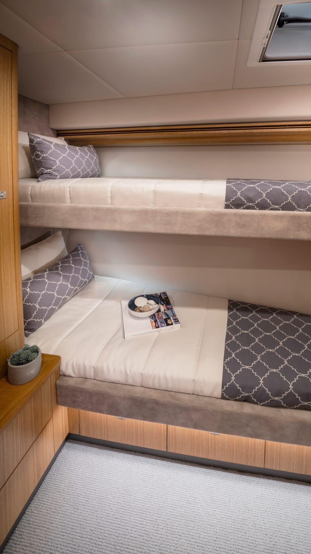 Riviera 5400 Sport Yacht Platinum Edition Forward Port Stateroom 01 – Satin Oak Timber Finish