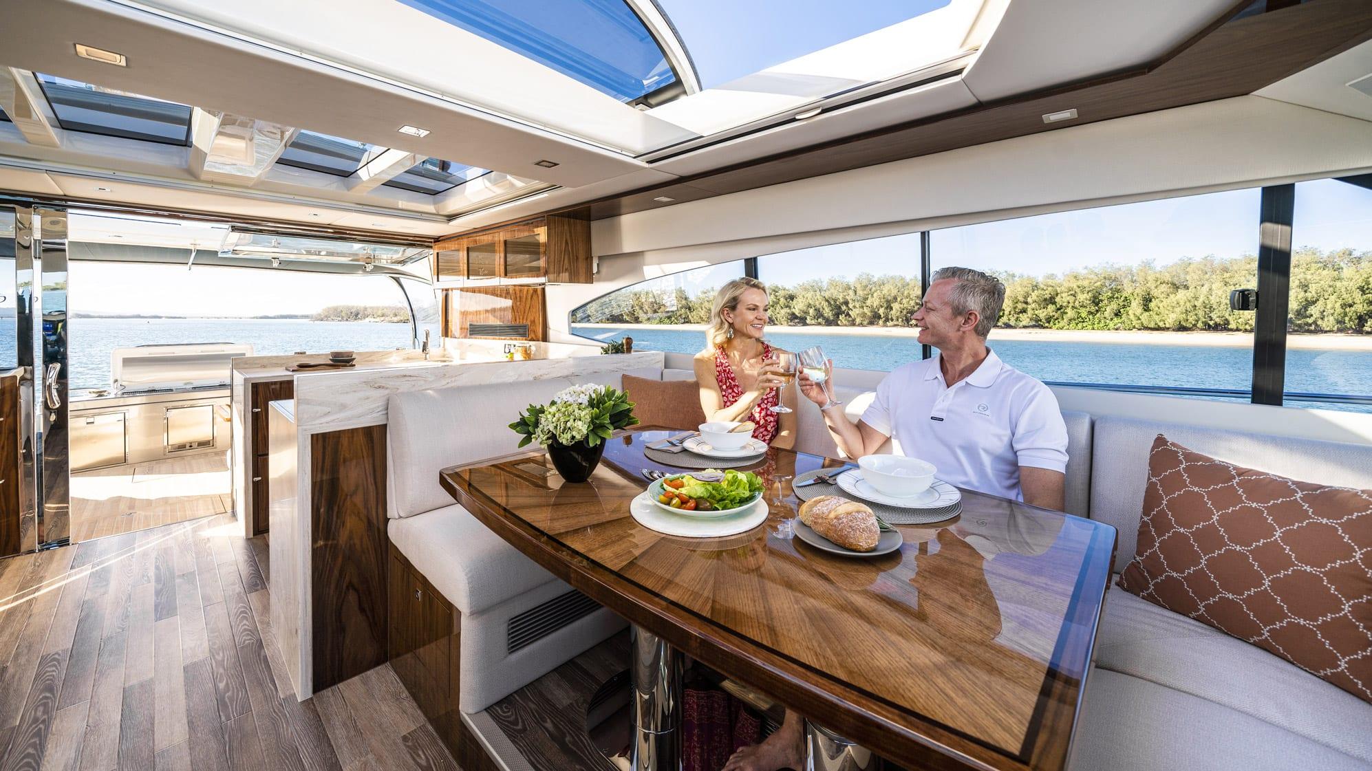 Riviera 6000 Sport Yacht Platinum Edition Dining 02 – Gloss Walnut Timber Finish