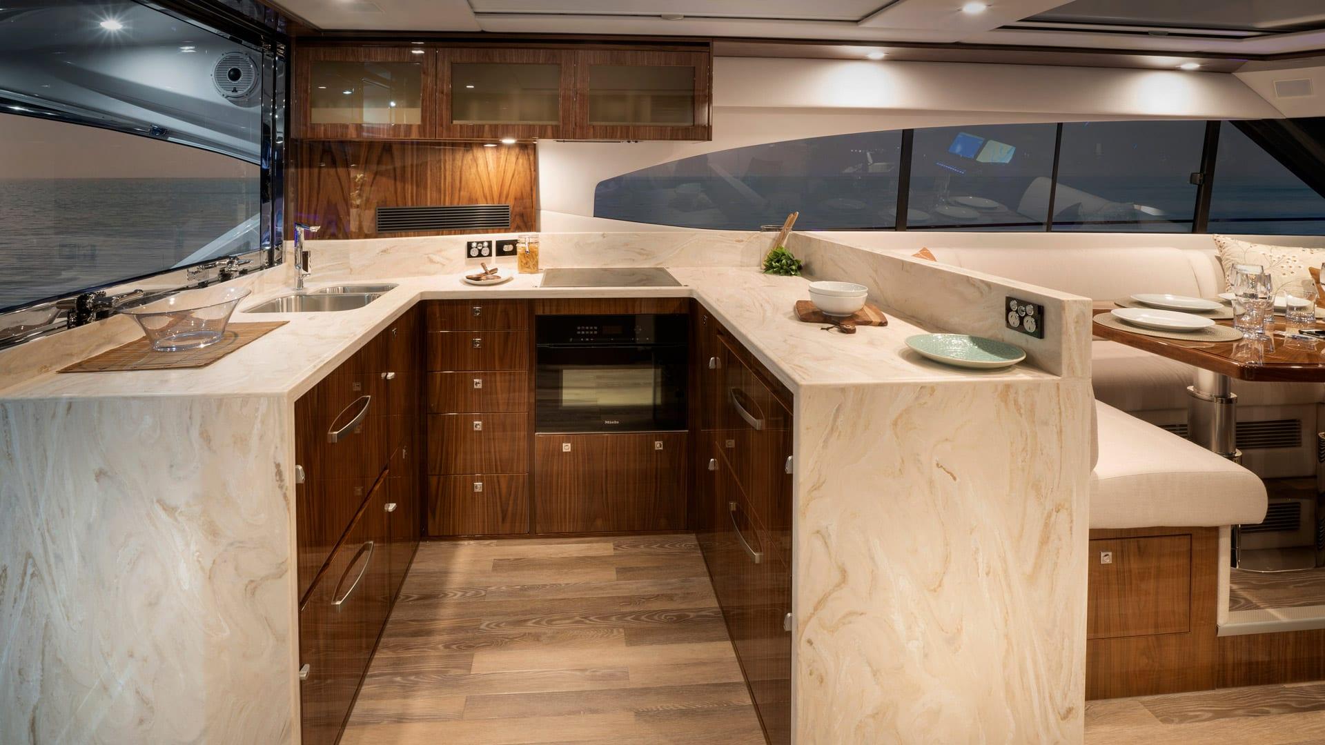 Riviera 6000 Sport Yacht Platinum Edition Galley 01 – Gloss Walnut Timber Finish