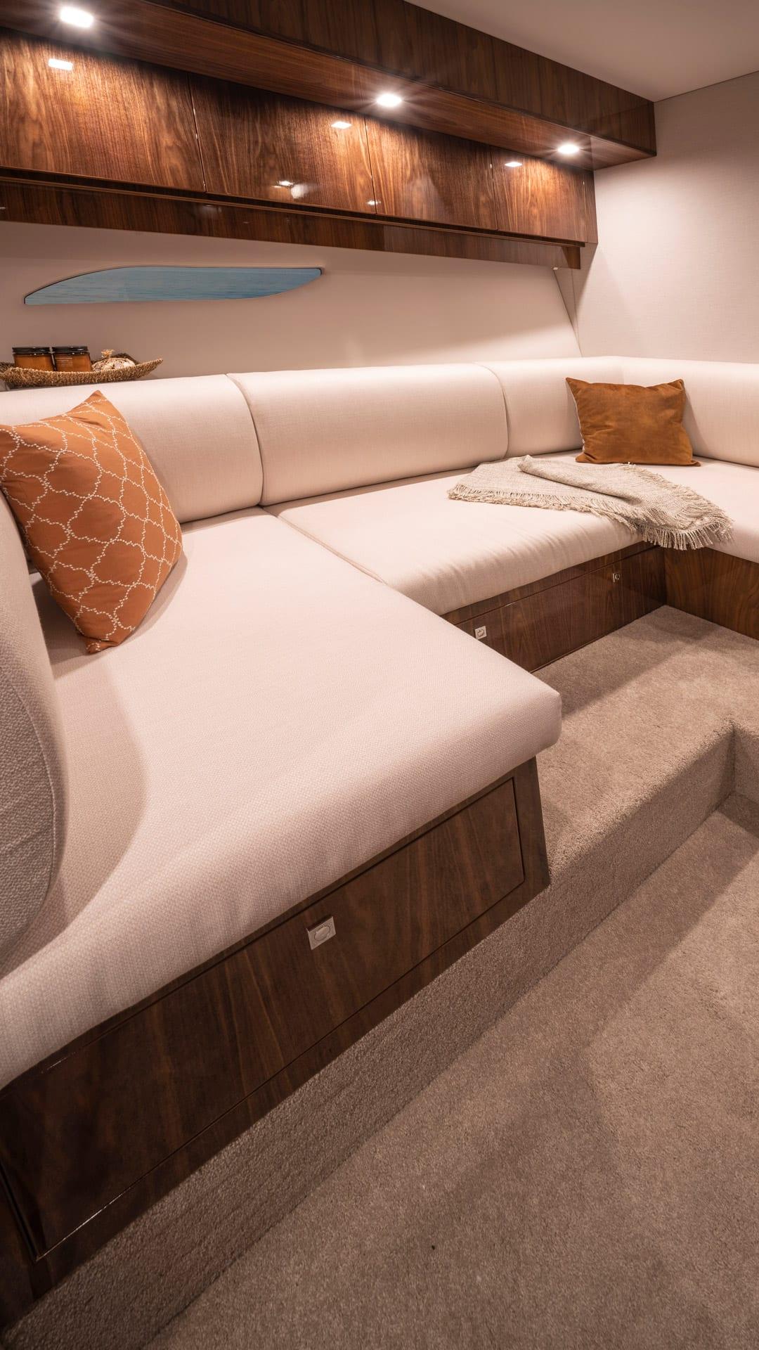 Riviera 6000 Sport Yacht Platinum Edition Lower Lounge 01 – Gloss Walnut Timber Finish