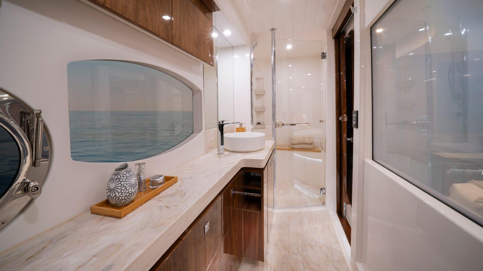 Riviera 6000 Sport Yacht Platinum Edition Master Ensuite 01 – Gloss Walnut Timber Finish